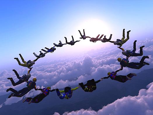 Współpraca w zespole - skok spadochroniarzy